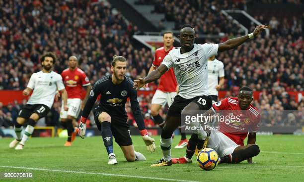 Sadio Mane of Liverpool competes with Eric Bailly of Manchester United during the Premier League match between Manchester United and Liverpool at Old...