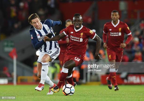 Sadio Mane of Liverpool competes with Grzegorz Krychowiak of West Bromwich Albion during The Emirates FA Cup Fourth Round match between Liverpool and...