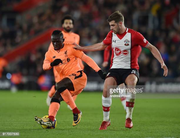 Sadio Mane of Liverpool competes with Jack Stephens of Southampton during the Premier League match between Southampton and Liverpool at St Mary's...