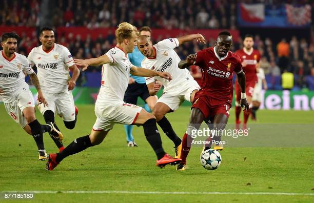Sadio Mane of Liverpool competes with Johannes Geis of Sevilla FC during the UEFA Champions League group E match between Sevilla FC and Liverpool FC...