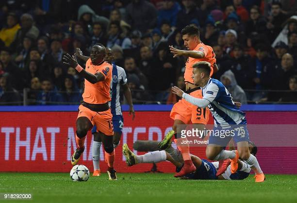 Sadio Mane of Liverpool competes with Otavio of FC Porto during the UEFA Champions League Round of 16 First Leg match between FC Porto and Liverpool...