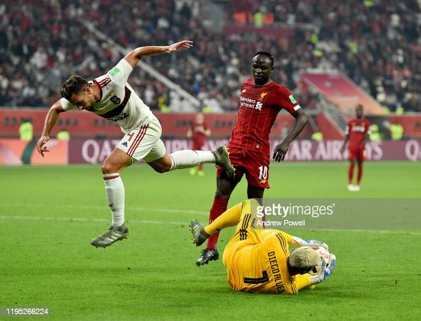 Sadio Mane of Liverpool competing with Pablo Mari and Diego Alves of CR Flamengo during the FIFA Club World Cup final match between Liverpool FC and...
