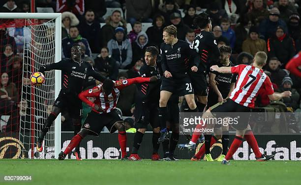 Sadio Mane of Liverpool concedes a penalty during the Premier League match between Sunderland and Liverpool at Stadium of Light on January 2 2017 in...