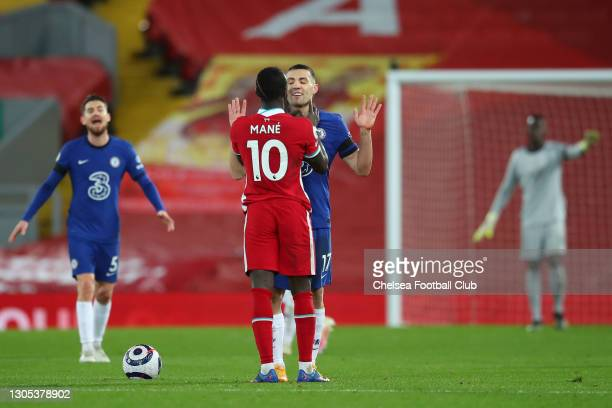 Sadio Mane of Liverpool confronts Mateo Kovacic of Chelsea during the Premier League match between Liverpool and Chelsea at Anfield on March 04, 2021...