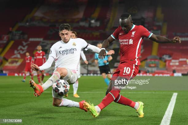 Sadio Mane of Liverpool crosses the ball whilst under pressure from Federico Valverde of Real Madrid during the UEFA Champions League Quarter Final...