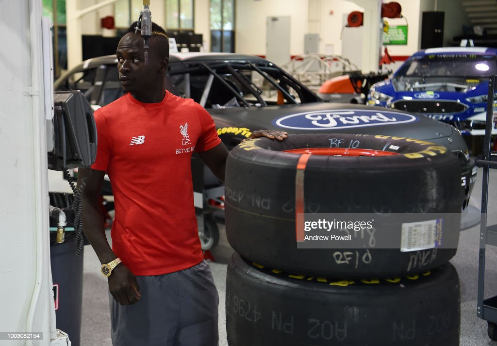 Liverpool Players Change Tyres at Roush Fenway NASCAR Shop