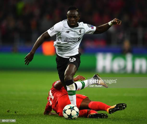 Sadio Mane of Liverpool escapes a challenge from Aleksandr Samedov of Spartak Moskva during the UEFA Champions League group E match between Spartak...
