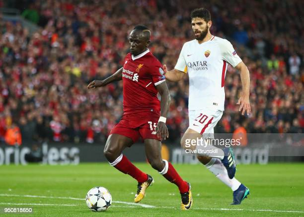 Sadio Mane of Liverpool evades Federico Fazio of AS Roma during the UEFA Champions League Semi Final First Leg match between Liverpool and AS Roma at...
