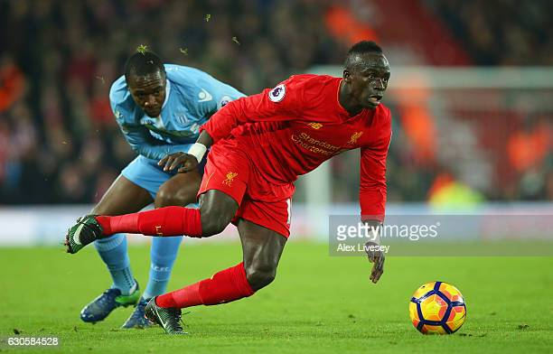 Sadio Mane of Liverpool evades Gianelli Imbula of Stoke City during the Premier League match between Liverpool and Stoke City at Anfield on December...
