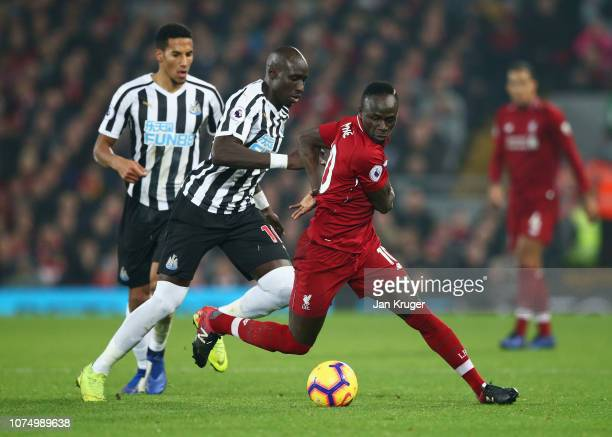 Sadio Mane of Liverpool evades Mohamed Diame of Newcastle United during the Premier League match between Liverpool FC and Newcastle United at Anfield...