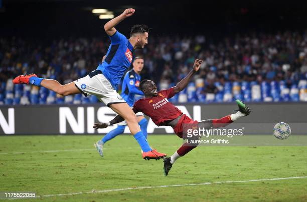 Sadio Mane of Liverpool fails to connect with a cross under pressure from Kostas Manolas of SSC Napoli during the UEFA Champions League group E match...