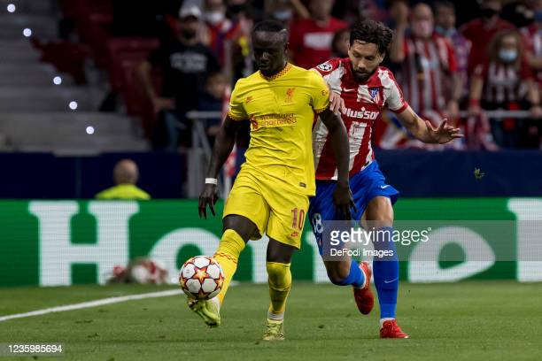 Sadio Mane of Liverpool FC and Felipe of Atletico de Madrid battle for the ball during the UEFA Champions League group B match between Atletico...