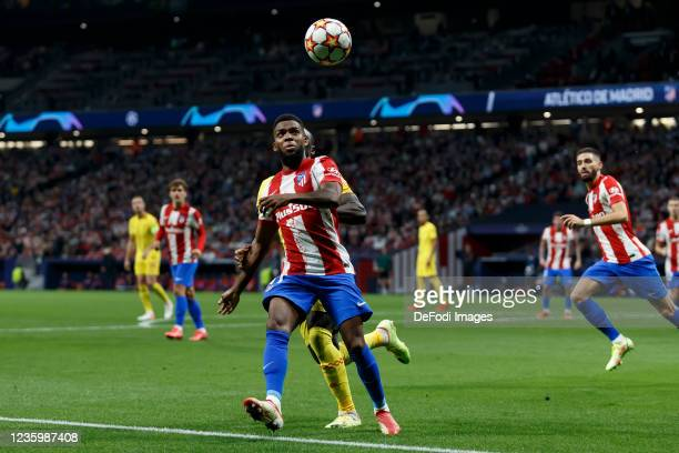 Sadio Mane of Liverpool FC and Thomas Lemar of Atletico de Madrid battle for the ball during the UEFA Champions League group B match between Atletico...