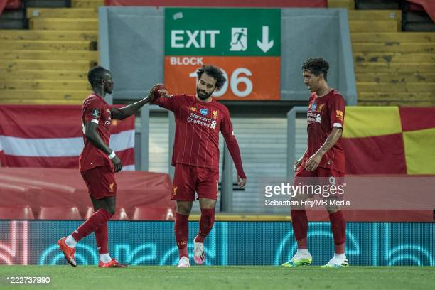 Sadio Mane of Liverpool FC celebrate with hes team mates Mohamed Salah, Roberto Firmino after scoring goal during the Premier League match between...