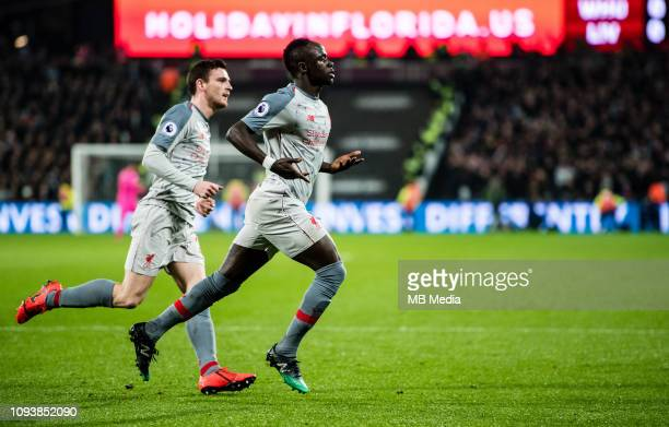 Sadio Mane of Liverpool FC celebrates after scoring 1st goal during the Premier League match between West Ham United and Liverpool FC at London...