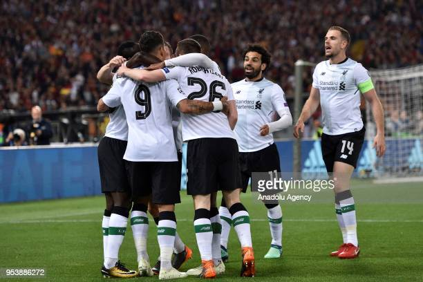 Sadio Mane of Liverpool FC celebrates his goal with his team mates during the UEFA Champions League semi final return match between AS Roma and...