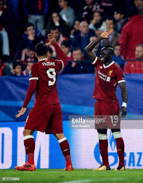 Sadio Mane of Liverpool FC celebrates with his teammate Roberto Firmino of Liverpool FC after scoring his team's second goal during the UEFA...