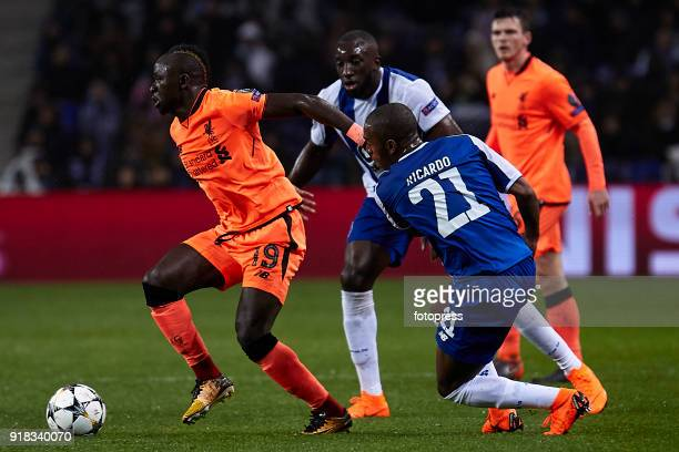 Sadio Mane of Liverpool FC is challenged by Moussa Marega and Ricardo Pereira of FC Porto during the UEFA Champions League Round of 16 First Leg...