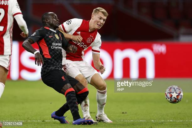 AMSTERDAM Sadio Mane of Liverpool FC Perr Schuurs or Ajax during the UEFA Champions League match in group D between Ajax Amsterdam and Liverpool FC...