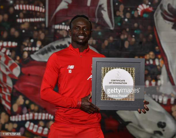 Sadio Mane of Liverpool FC pose for a picture with his Ballon D'or Nominations at Melwood Training Ground on November 12, 2019 in Liverpool, England.