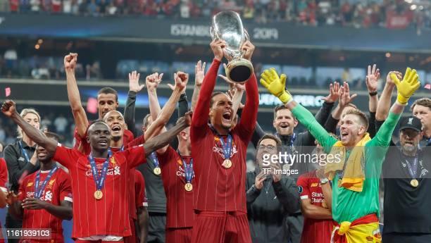 Sadio Mane of Liverpool FC Virgil van Dijk of Liverpool FC Goalkeeper Adrian of Liverpool FC and Head coach Juergen Klopp of Liverpool FC celebrate...