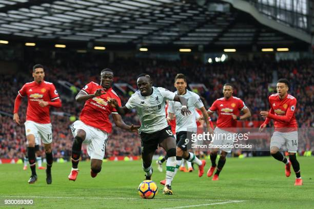 Sadio Mane of Liverpool gets away from Eric Bailly of Man Utd as he struggles get a late shot in during the Premier League match between Manchester...