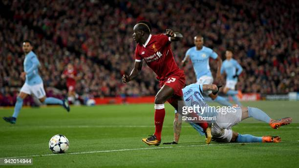 Sadio Mane of Liverpool gets past Nicolas Otamendi of Manchester City during the UEFA Champions League Quarter Final Leg One match between Liverpool...