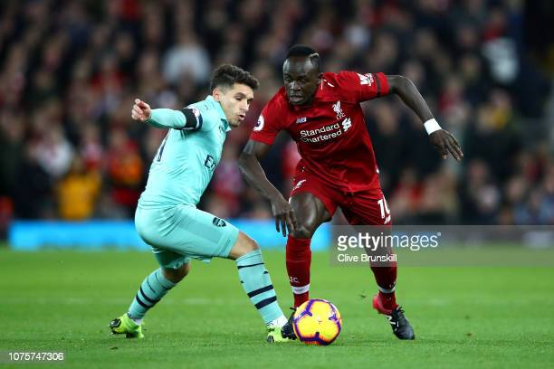 Sadio Mane of Liverpool goes past Lucas Torreira of Arsenal during the Premier League match between Liverpool FC and Arsenal FC at Anfield on...