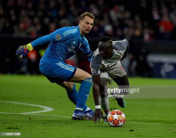 Sadio Mane of Liverpool goes past Manuel Neuer of FC Bayern Muenchen to score during the UEFA Champions League Round of 16 Second Leg match between...