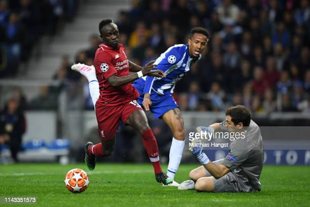 Sadio Mane of Liverpool goes round Iker Casillas of FC Porto but shoots wide during the UEFA Champions League Quarter Final second leg match between...