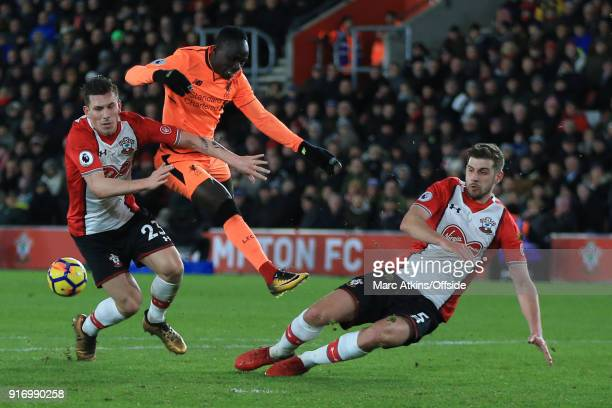 Sadio Mane of Liverpool has a shot blocked by PierreEmile Hojbjerg and Jack Stephens of Southampton during the Premier League match between...