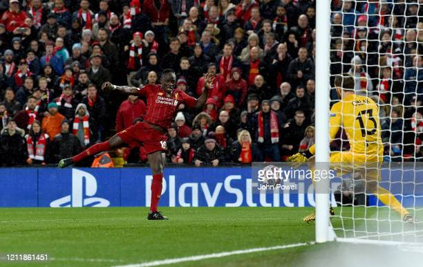 Sadio Mane of Liverpool has a shot saved by Jan Oblak of Atletico Madrid during the UEFA Champions League round of 16 second leg match between...