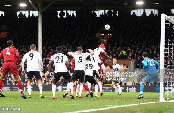 Sadio Mane of Liverpool heads the ball towards the goal but hits tips it over the cross bar during the Premier League match between Fulham FC and...