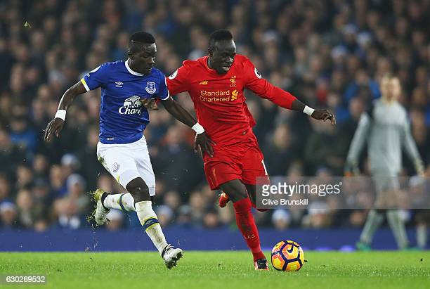 Sadio Mane of Liverpool holds off Idrissa Gueye of Everton during the Premier League match between Everton and Liverpool at Goodison Park on December...