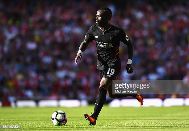 Sadio Mane of Liverpool in action during the Premier League match between Arsenal and Liverpool at Emirates Stadium on August 14 2016 in London...