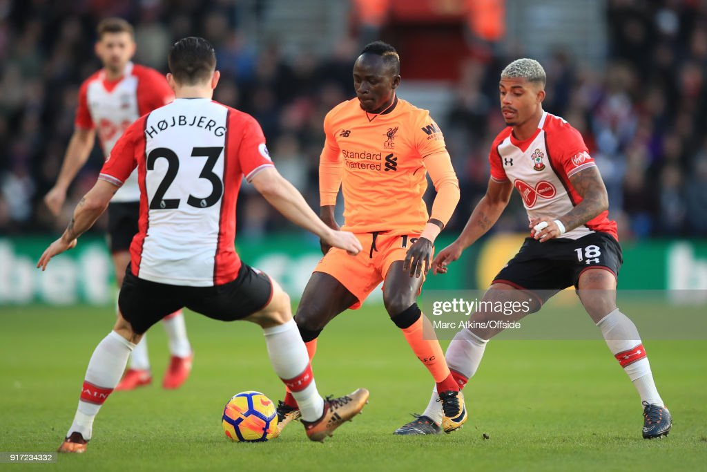 Sadio Mane of Liverpool in action with Pierre-Emile Hojbjerg and Mario Lemina of Southampton during the Premier League match between Southampton and Liverpool at St Mary's Stadium on February 11, 2018 in Southampton, England.