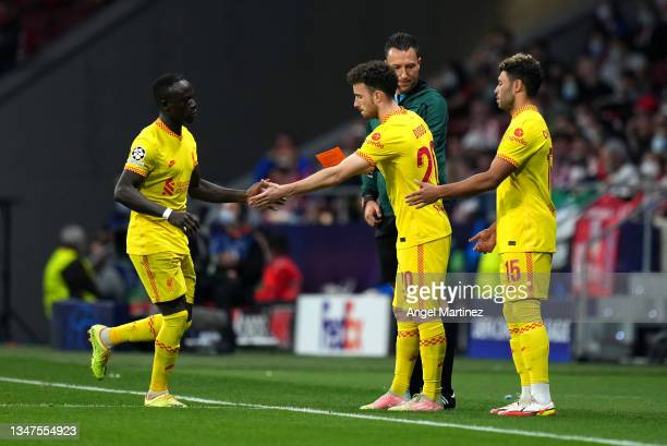 Sadio Mane of Liverpool interacts with Diogo Jota of Liverpool as he is substituted during the UEFA Champions League group B match between Atletico...