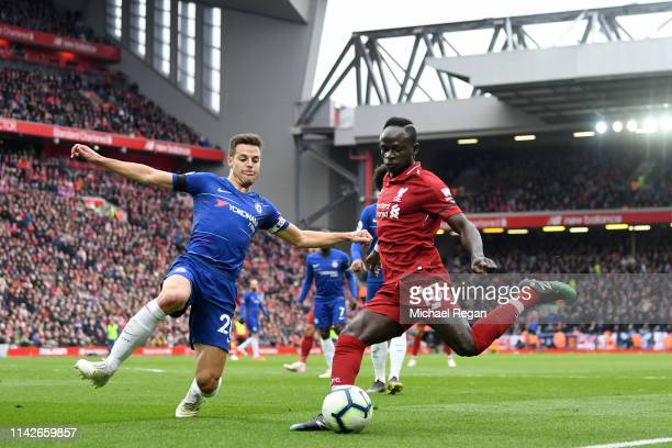 Sadio Mane of Liverpool is blocked by Cesar Azpilicueta of Chelsea during the Premier League match between Liverpool FC and Chelsea FC at Anfield on...