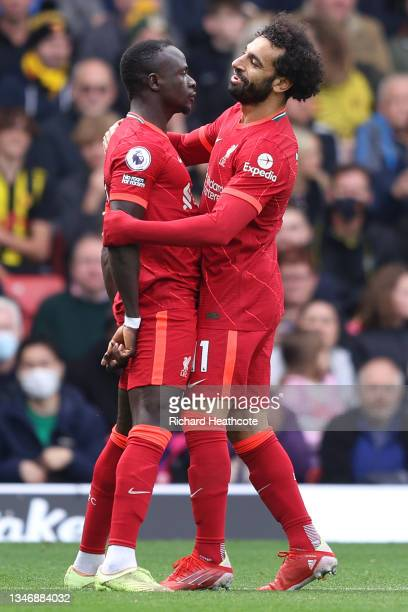Sadio Mane of Liverpool is celebrates with teammate Mohamed Salah after scoring their side's first goal during the Premier League match between...