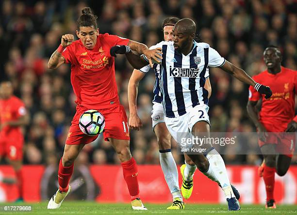 Sadio Mane of Liverpool is challenged Allan Nyom of West Bromwich Albion during the Premier League match between Liverpool and West Bromwich Albion...