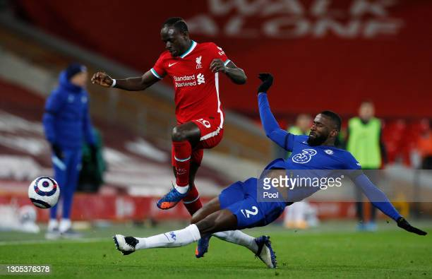 Sadio Mane of Liverpool is challenged by Antonio Ruediger of Chelsea during the Premier League match between Liverpool and Chelsea at Anfield on...