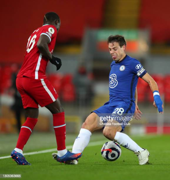 Sadio Mane of Liverpool is challenged by Cesar Azpilicueta of Chelsea during the Premier League match between Liverpool and Chelsea at Anfield on...