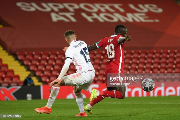 Sadio Mane of Liverpool is challenged by Federico Valverde of Real Madrid during the UEFA Champions League Quarter Final Second Leg match between...