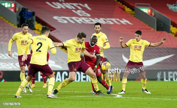 Sadio Mane of Liverpool is challenged by James Tarkowski of Burnley during the Premier League match between Liverpool and Burnley at Anfield on...