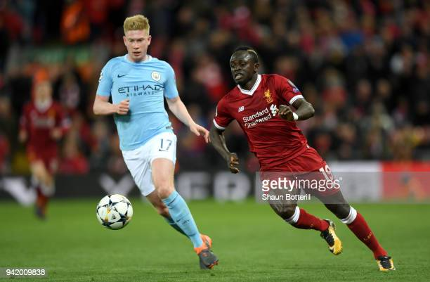 Sadio Mane of Liverpool is challenged by Kevin De Bruyne of Manchester City during the UEFA Champions League Quarter Final Leg One match between...