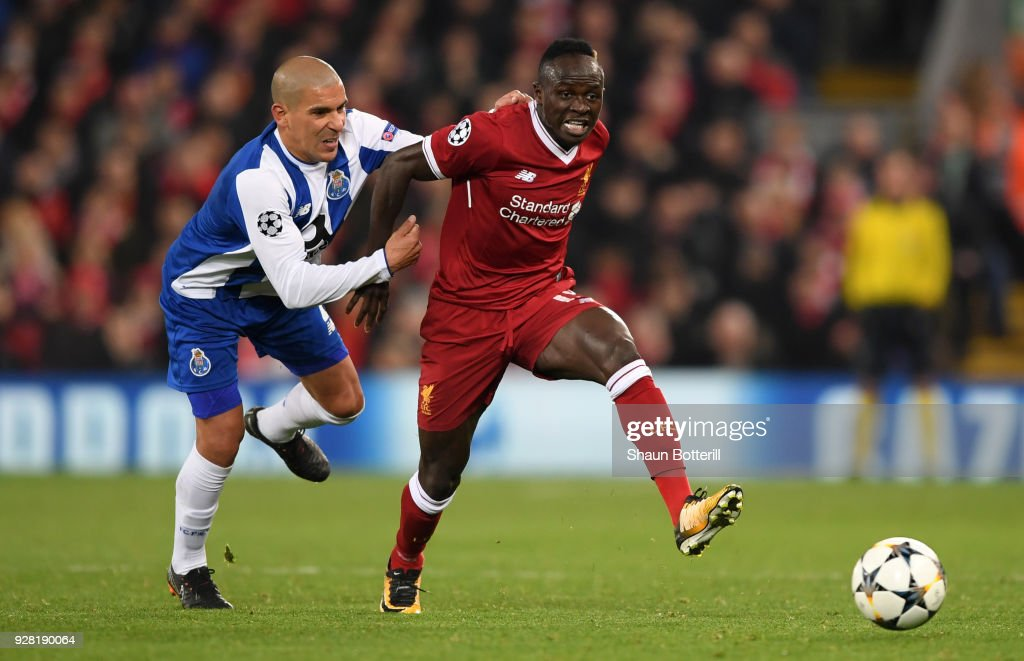 Sadio Mane of Liverpool is challenged by Maximiliano of FC Porto during the UEFA Champions League Round of 16 Second Leg match between Liverpool and FC Porto at Anfield on March 6, 2018 in Liverpool, United Kingdom.