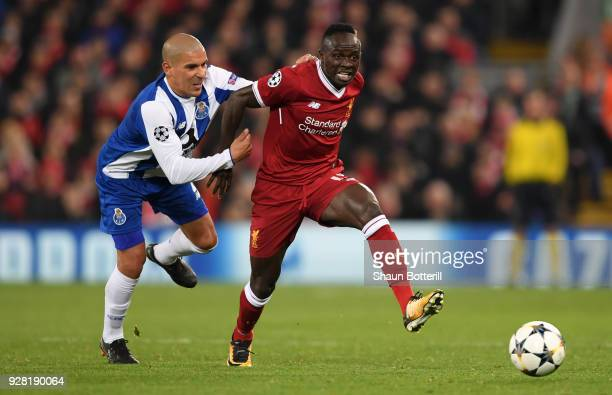 Sadio Mane of Liverpool is challenged by Maximiliano of FC Porto during the UEFA Champions League Round of 16 Second Leg match between Liverpool and...
