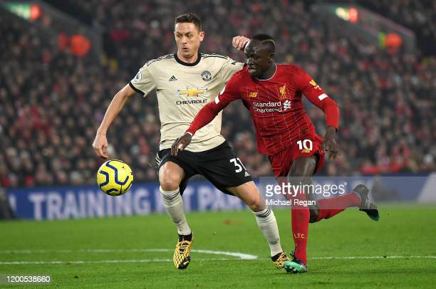 Sadio Mane of Liverpool is challenged by Nemanja Matic of Manchester United during the Premier League match between Liverpool FC and Manchester...