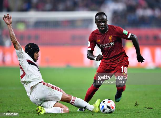 Sadio Mane of Liverpool is challenged by Rafinha of CR Flamengo during the FIFA Club World Cup 2019 final match between Liverpool FC and CR Flamengo...