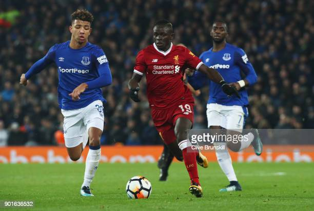 Sadio Mane of Liverpool is chased by Mason Holgate and Yannick Bolasie during the Emirates FA Cup Third Round match between Liverpool and Everton at...